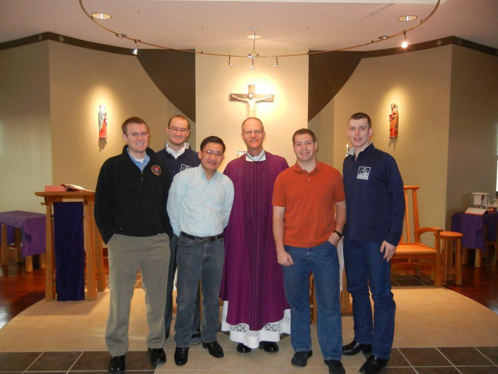 Seminarians Clark Lenz, Joe Hurdle, Linh Vu, Dylan Ostdiek and Kellen Washut with Bishop Etienne
