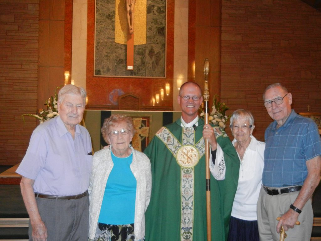(left) Joe and Eldine Maixner and Elizabeth and Robert Steinle (right) with Bishop Etienne
