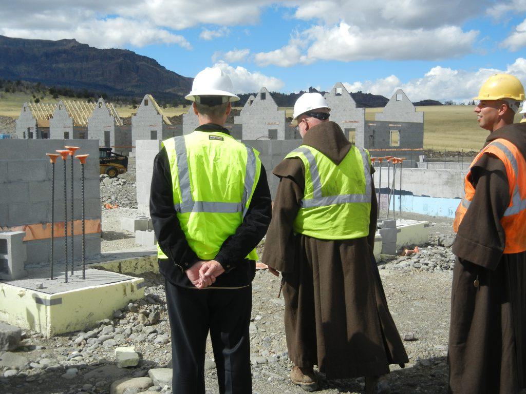 Standing in front of the foundation for the Chapter House.  Hermitages visible in the background.