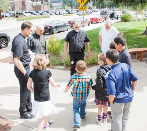 Clergy and youth play hacky sack.