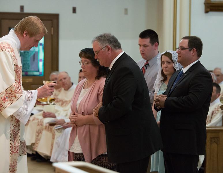Fr. Kinstetter's family present the gifts